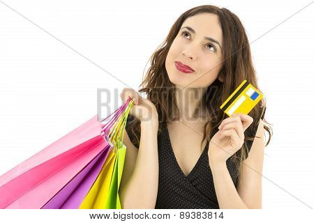 Shopping Woman With A Credit Card Thinking