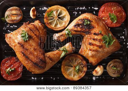Chicken Legs And Vegetables On Grill Pan Closeup. Top View Horizontal