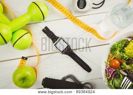 Watch with indicators of healthy lifestyle on wooden table