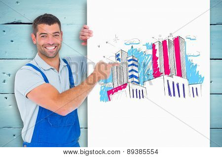 Repairman in overalls pointing at placard against painted blue wooden planks