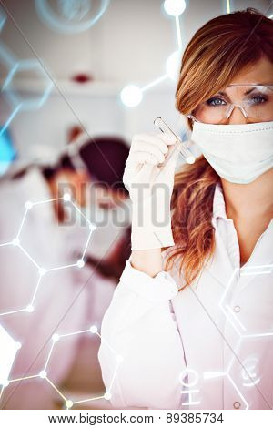 Science formula against scientist woman wearing a mask and holding a test tube