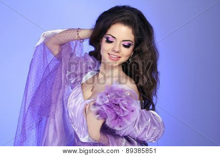Beautuful Brunette Smiling Girl With Beauty Makeup, Long Wavy Hair, Expensive Jewelry.
