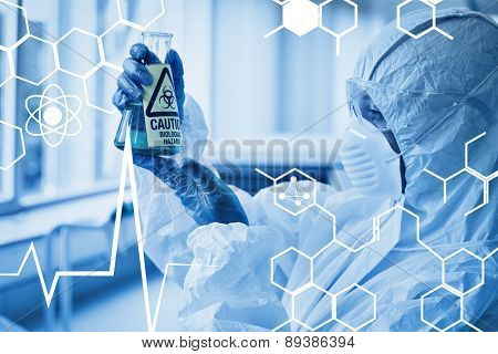 Science graphic against scientist in protective suit with hazardous chemical in flask at lab