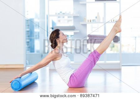 Fit woman raising her legs in medical office