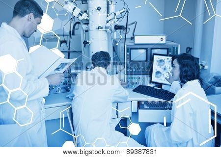 Science graphic against biochemistry students using large microscope and computer