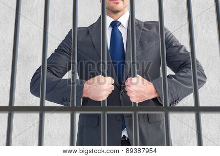 Businessman holding his hands out against white background