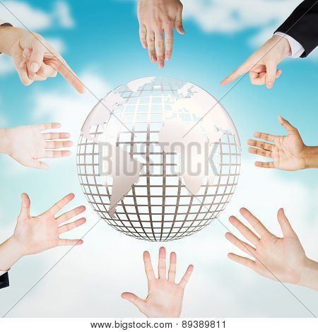 Hands showing against blue sky