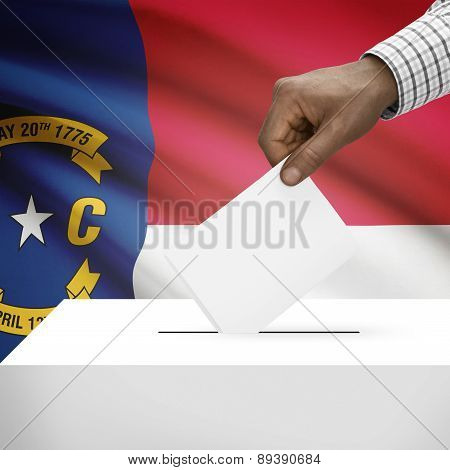 Voting Concept - Ballot Box With Us State Flag On Background - North Carolina