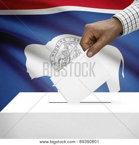 Voting Concept - Ballot Box With Us State Flag On Background - Wyoming