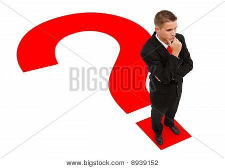 Businessman Standing On Question Mark
