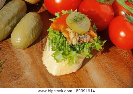 Slice Of Baguette Witht Herring Fillets In Tomato Sauce