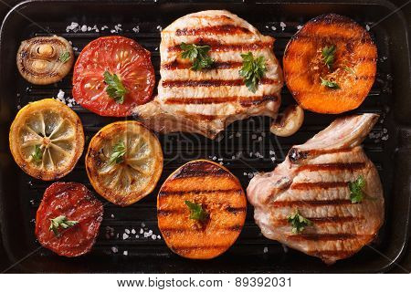 Grilled Pork And Vegetables On The Grill Pan. Top View Horizontal