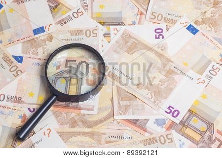 Magnifier Over Fifty Euro Notes