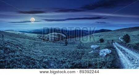 Road On Hillside Meadow In Mountain Panorama At Night