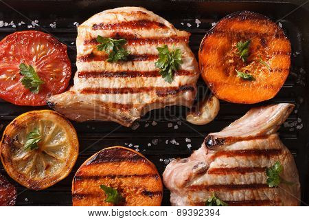 Grilled Pork And Pumpkin On A Grill. Top View Horizontal Macro