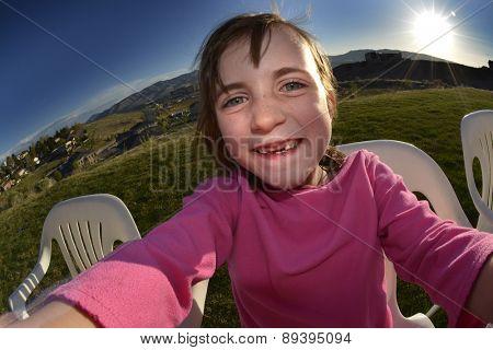 Little girl summer selfie in sunshine day