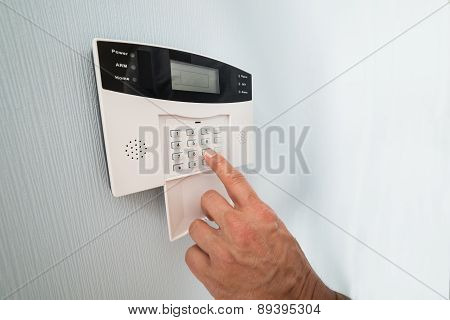 Person's Hand Entering Code