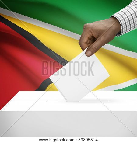 Ballot Box With National Flag On Background - Guyana
