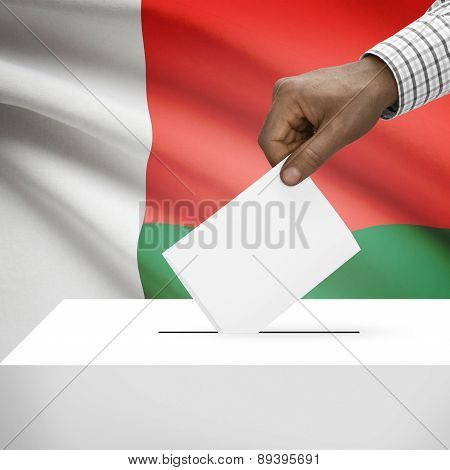 Ballot Box With National Flag On Background - Madagascar