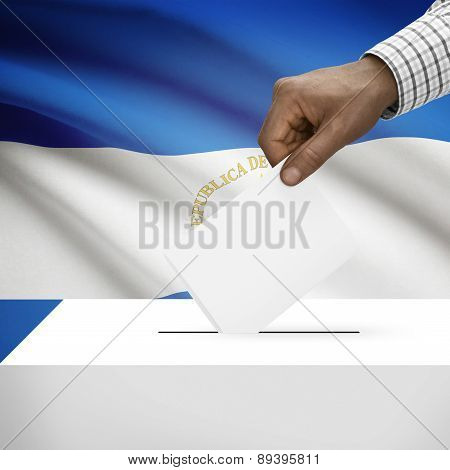 Ballot Box With National Flag On Background - Nicaragua