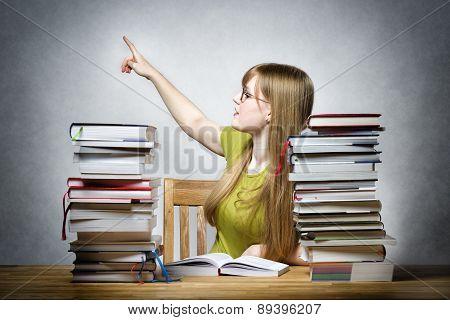 Female Teacher Pointing Back