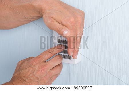 Hand Entering Pin In Security System
