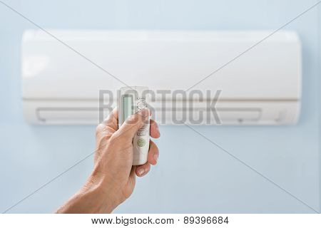 Person Hand Holding Air Conditioner Remote