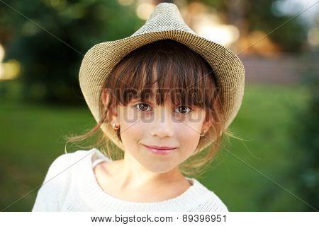 Happy Little Girl In A Hat