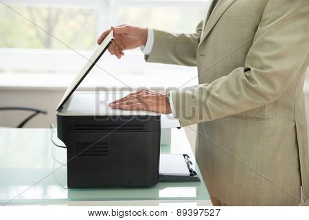 Businessman Using Scanner