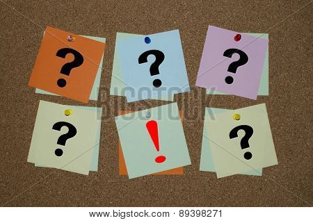 Question mark and exclamation mark on paper notes