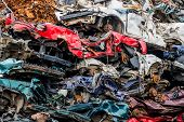 stock photo of scrap-iron  - old cars were scrapped in a trash compactor - JPG
