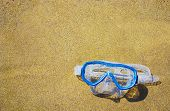 picture of rubber mask  - close up of a diving mask on a golden beach - JPG