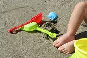 stock photo of children beach  - Child playing in sand - JPG