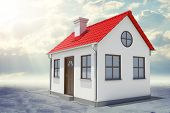 picture of red roof  - Small house with red roof and sun on abstract grey sky background - JPG