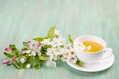 pic of apple blossom  - white cup saucer white apple blossom cherry blossom mint on turquoise background - JPG