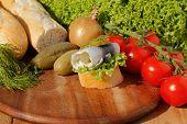 image of baguette  - Baguette slice with sour herring pickled herring garnished with lettuce Ger - JPG