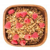 image of cinnamon  - Cinnamon granola with raspberries in a wooden bowl - JPG