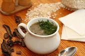 pic of porridge  - dried mushrooms and porridge soup in a porcelain pot - JPG