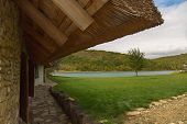foto of house woods  - house with a thatched roof on the lake - JPG