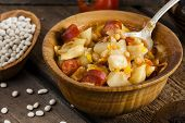 image of hungarian  - Hungarian goulash with beans and peppers on wooden board - JPG