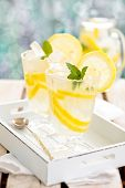 stock photo of refreshing  - Refreshing lemonade with mint on wooden table - JPG