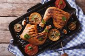 stock photo of grill  - Chicken legs grilled on a grill pan close - JPG