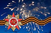 picture of patriot  - Order of the Patriotic war and George Ribbon against salute - JPG