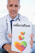stock photo of prescription pad  - The word education and portrait of a male doctor showing a blank prescription sheet against autism awareness heart - JPG
