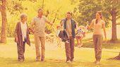 foto of extended family  - Extended family having fun in the park - JPG