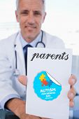 pic of prescription pad  - The word parents and portrait of a male doctor showing a blank prescription sheet against autism awareness day - JPG