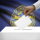 picture of nebraska  - Ballot box with US state flag on background  - JPG