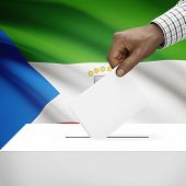 stock photo of guinea  - Ballot box with flag on background  - JPG