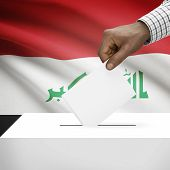 pic of iraq  - Ballot box with flag on background  - JPG