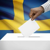 foto of sweden flag  - Ballot box with flag on background  - JPG